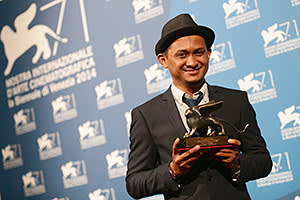 Director Sidi Saleh poses onstage with the Orizzonti Award For Best Short Film he received for his movie 'Maryam' during the award winners photocall of the 71st Venice Film Festival on September 6, 2014 in Venice, Italy