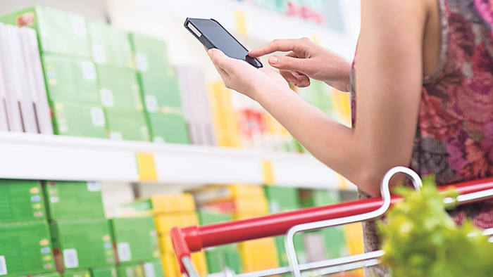 grocery shopper using mobile phone