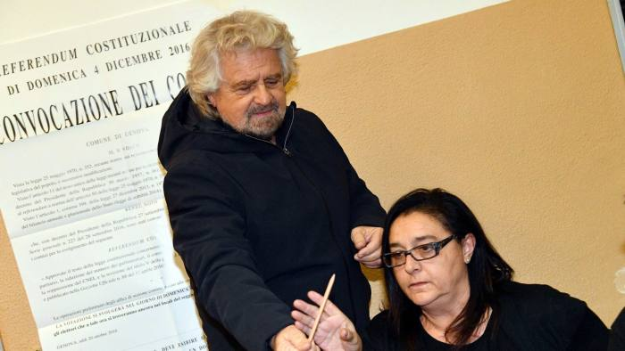 5-Star Movement leader Beppe Grillo arrives at a polling station to vote in a referendum on constitutional reforms, in Genoa, Italy, Sunday, Dec. 4, 2016. Italians vote Sunday in a referendum on constitutional reforms that is being closely watched abroad to see if Italy becomes the next country to reject the political status quo. (Luca Zennaro/ANSA via AP)