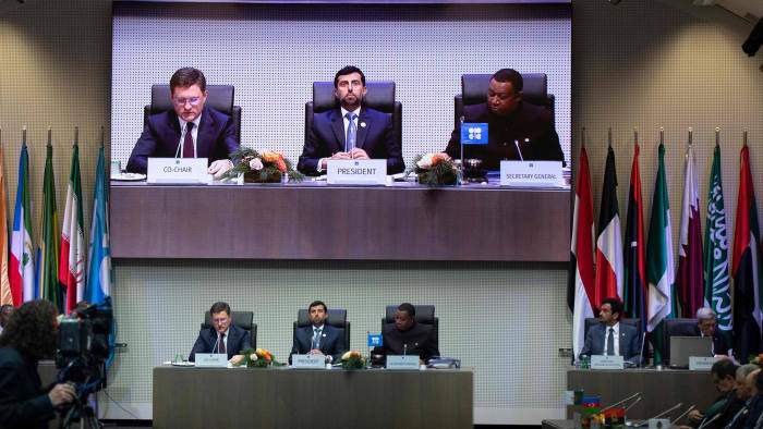 (FILES) In this file photo taken on December 07, 2018 (LtoR) Russian Minister of Energy of Russia Alexander Novak, Organization of the Petroleum Exporting Countries' (OPEC) President UAE Energy Minister Suhail al-Mazrouei and OPEC Secretary General Mohammed Sanusi Barkindo of Nigeria speak during a ministerial level meeting during with OPEC members and non members during the 175th OPEC Conference on December 7, 2018 in Vienna, Austria. - The OPEC club of oil-producing countries meets on March 2, 2020 in Vienna as they weigh how to react to a sharp drop in global oil demand due to the outbreak of the new coronavirus. (Photo by JOE KLAMAR / AFP) (Photo by JOE KLAMAR/AFP via Getty Images)