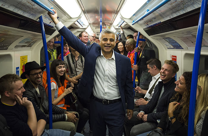 LONDON, ENGLAND - AUGUST 20: London Mayor Sadiq Khan stands between passengers in the first Night Tube train along the Victoria line on August 20, 2016 in London, England. The London Underground's 24-hour service begins for the first time in its 153 year history. The new Night Tube will see both the Victoria and Central lines run through the night on Fridays and Saturdays. (Photo by Jack Taylor/Getty Images)