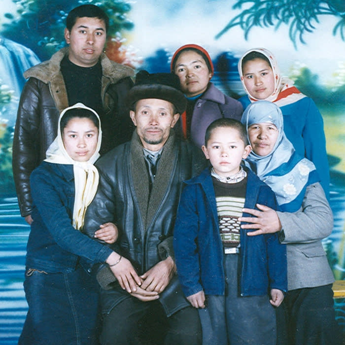 laura pitel Uygur top left: Muhammad Abdullah Mamattohti, man in middle Mamattohi Sayit, woman with white spotted headscarf younger sister, Rizwangul Mammattohiti, young boy, her brother Baimmehan heyt