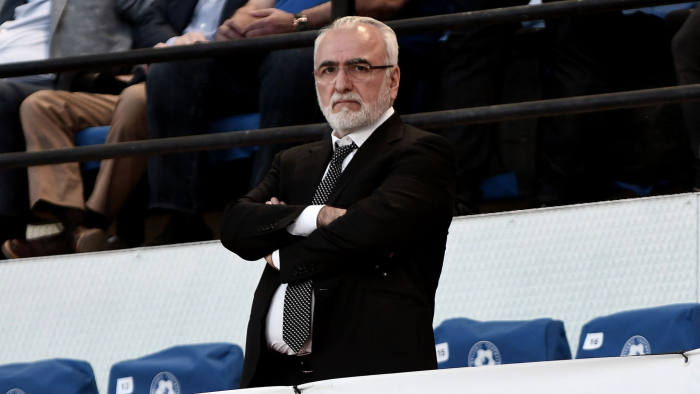A picture taken on May 6, 2017, shows PAOK's Greek-Russian president Ivan Savvidis watching the cup-final match between PAOK Thessaloniki and AEK Athens in Volos. The president of Greek club PAOK on March 13 apologised after storming onto the pitch with a holstered gun tucked in his belt, an incident that prompted the indefinite suspension of the championship. / AFP PHOTO / SAKIS MITROLIDIS (Photo credit should read SAKIS MITROLIDIS/AFP via Getty Images)