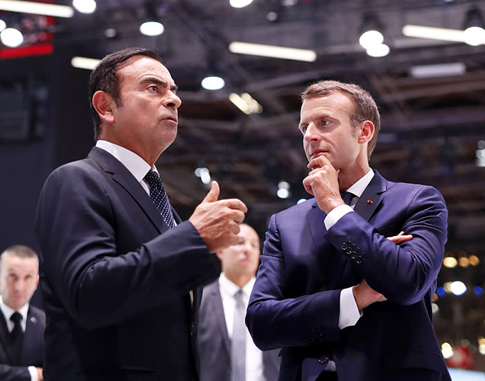 French President Emmanuel Macron (R) listens to CEO of French car maker Renault Carlos Ghosn during an official visit at the Paris auto show in Paris, on October 3, 2018. (Photo by Ian LANGSDON / POOL / AFP) (Photo credit should read IAN LANGSDON/AFP via Getty Images)