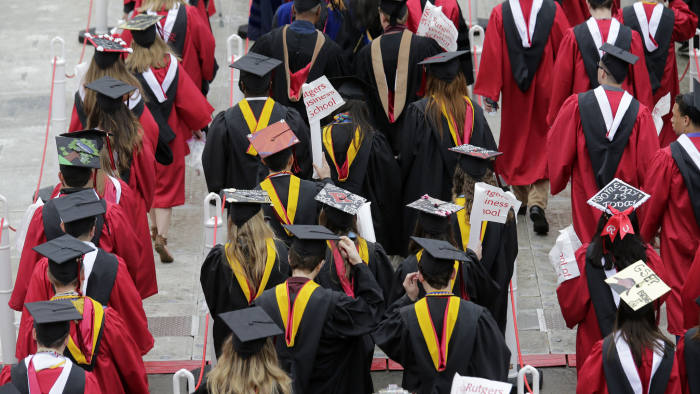New graduates walk into the High Point Solutions Stadium before the start of the Rutgers University graduation ceremony in Piscataway Township, N.J., Sunday, May 13, 2018. Family and friends watched as over 18,000 graduates received their degrees on Mother's Day. (AP Photo/Seth Wenig)