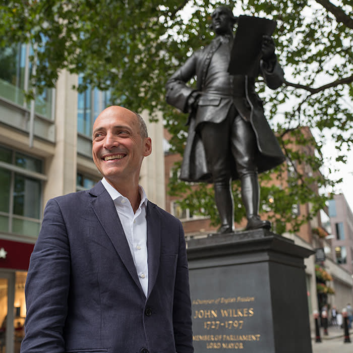 Centre for London director Ben Rogers in Holborn by the statue of John Wilkes, 18th century Lord Mayor of London, champion of the capital and a critic of national government