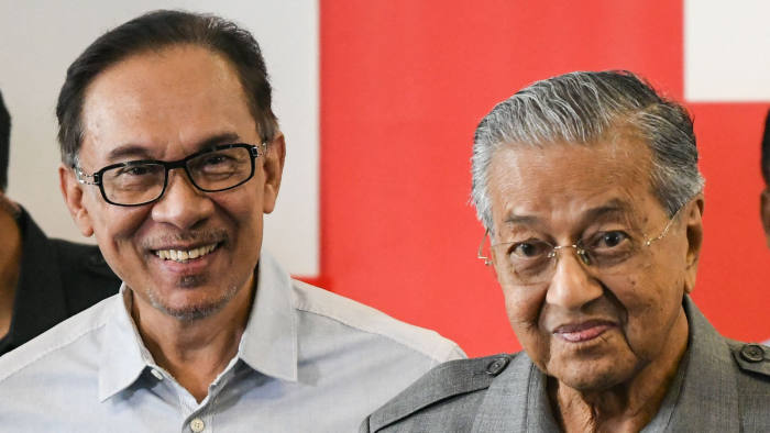 Anwar Ibrahim, left, and Mahathir Mohamad in 2018. Their political alliance has been made all the more remarkable given their difficult history