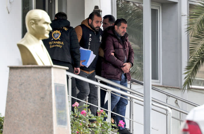 Turkish police officers escort suspects, accused of involvement of Nissan's former CEO Carlos Ghosn passage through Istanbul, after he fled Japan, in Istanbul, Friday, Jan. 3, 2020. Ghosn's daring escape spanned three continents and involved private planes, multiple passports and international intrigue. Turkey detained seven people Thursday as part of an investigation into how Ghosn passed through the country, and they were appearing in court Friday. The private DHA news agency reported that those detained were four pilots, a cargo company manager and two airport workers. (Ugur Can/DHA via AP)