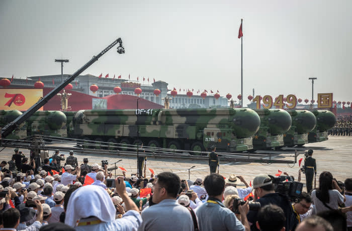 Military vehicles carry the DF-41 intercontinental nuclear missile through Tiananmen Square during a parade in Beijing on October 1