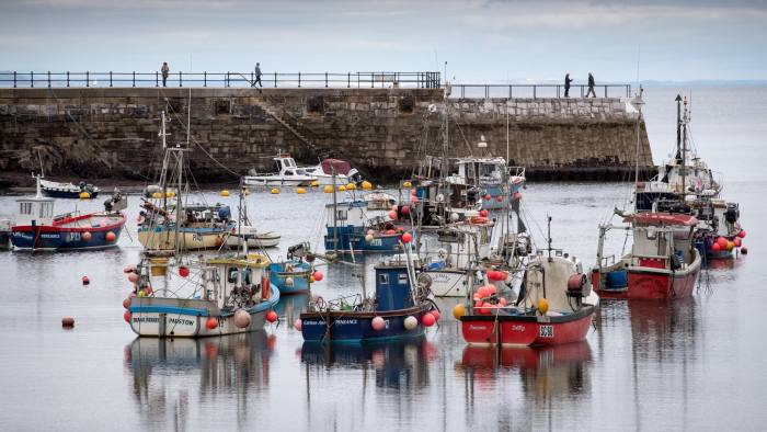 MEVAGISSEY, ENGLAND - OCTOBER 09: Fishing boats are seen in the harbour in the village of Mevagissey which has submitted plans to limit the number of second homes on October 9, 2017 in Cornwall, England. The picturesque Cornish coastal fishing village has submitted plans to Cornwall Council to block outsiders buying new-builds to use as holiday homes in an attempt to give local first-time buyers better chances of getting on the property ladder rather than being outbid by wealthy second home owners. The village's Neighbourhood Development Plan has highlighted that currently twenty six per cent of the homes in Mevagissey are holiday homes with average prices, according to Rightmove, of £299,587, nearly £50,000 more than the Cornish average of £250,000, and 20 times the local average wage of £15,458. It also noted that although since 1930 the buildings in the village have more than doubled, the permanent population of Mevagissey has actually fallen over the last 200 years. If the plans are approved they will be returned to the village to be voted on in a referendum and will follow attempts by other communities in Cornwall which have introduced new-build bans including most notably St Ives. (Photo by Matt Cardy/Getty Images)