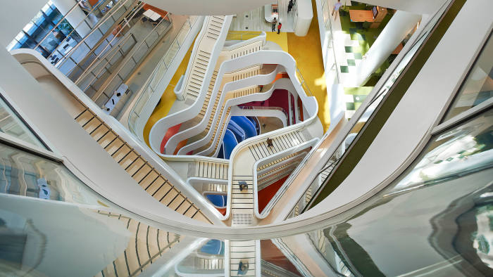 Medibank's Melbourne headquarters features a sci-fi swirl of stairs and various collaborate areas