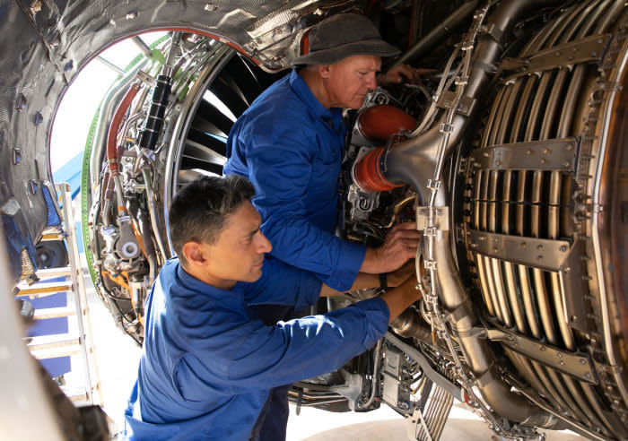 Alice Springs Aircraft Storage. Pic shows: Rob Cecil (from Croydon) and Australian Andrew Coop (hat) works on a 737 Max engine