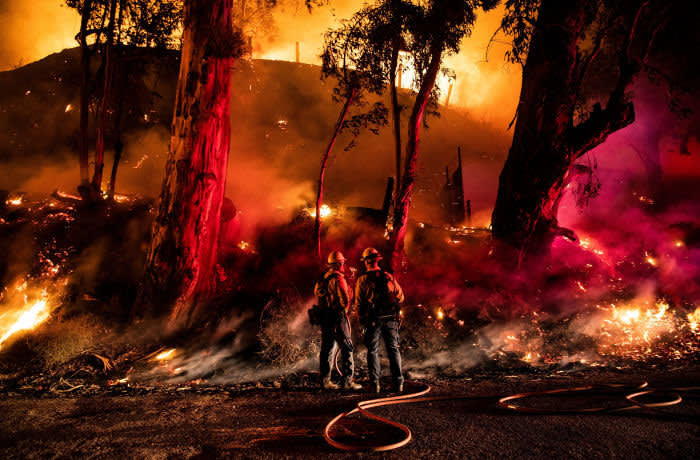 Mandatory Credit: Photo by ETIENNE LAURENT/EPA-EFE/Shutterstock (10462551l) Firefighters work at containing the Maria fire spreading in the hills near Ventura, North West of Los Angeles, California, USA, 01 November 2019. Media reports say that the fire that broke out overnight has already consumed more than 7,000 acres of agricultural land and that authorities have issued mandatory evacuations for many homes in the region. Maria Fire in Simi Valley, Ventura, USA - 01 Nov 2019