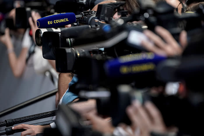 Journalists converging outside the Europa Building in Brussels in June. When he arrived in Brussels, Barker assumed his focus would be 'the intricacies of single market regulation', not events that left him physically shaken