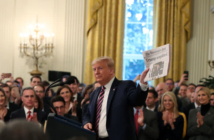 WASHINGTON, DC - FEBRUARY 06: U.S. President Donald Trump holds up a newspaper as he speaks one day after the U.S. Senate acquitted on two articles of impeachment, in the East Room of the White House February 6, 2020 in Washington, DC. After five months of congressional hearings and investigations about President Trump's dealings with Ukraine, the U.S. Senate formally acquitted the president of charges that he abused his power and obstructed Congress. (Photo by Mark Wilson/Getty Images)