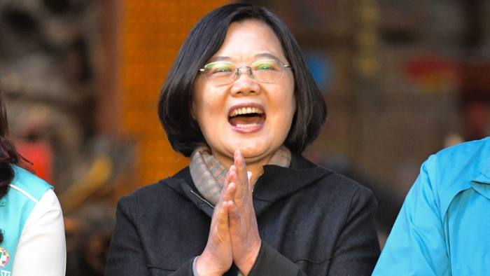 This picture taken on December 3, 2019 shows Taiwan's President and 2020 presidential candidate Tsai Ing-wen clapping during an election campaign event at the Jienan Taoist temple in Pingzhang district in Taoyuan. - Taiwan's President Tsai Ing-wen is riding high in the polls as she seeks a second term, a remarkable reversal of fortune aided by bellicose threats from Beijing and unease over political unrest in Hong Kong. Tsai, 63, is up against Han Kuo-yu of the Beijing-friendly Kuomintang (KMT) party, who had a stratospheric rise last year in local elections but has struggled on the campaign trail. (Photo by Sam YEH / AFP) / TO GO WITH Taiwan-politics-vote-China-US,FOCUS by Amber Wang (Photo by SAM YEH/AFP via Getty Images)