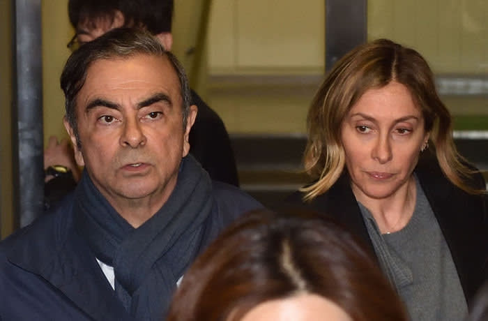 (FILES) In this file photo taken on April 3, 2019 Former Nissan Chairman Carlos Ghosn (L) and his wife Carole (R) leave the office of his lawyer in Tokyo. - Carole Ghosn, who not so long ago was an influential but discreet figure in the New York fashion world, has been thrust into the limelight by her tycoon husband Carlos' arrest and subsequent flight from Japan. (Photo by Kazuhiro NOGI / AFP) (Photo by KAZUHIRO NOGI/AFP via Getty Images)