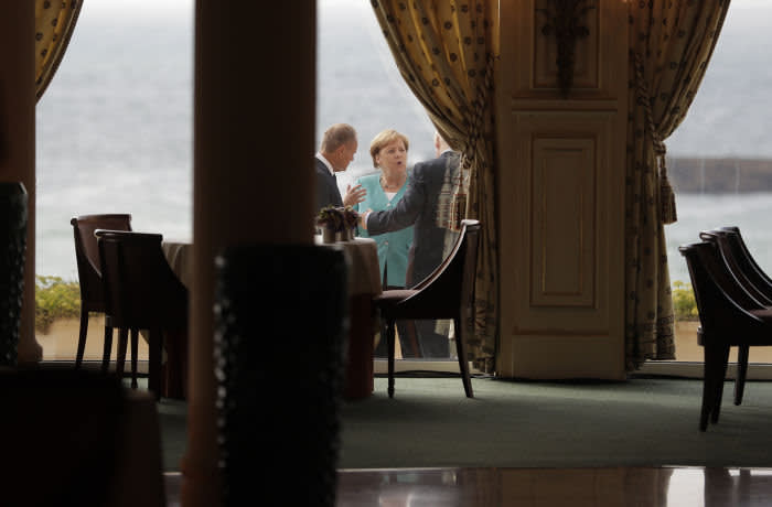 epa07790591 German Chancellor Angela Merkel, center, talks to President of the European Council Donald Tusk, left, during a G7 coordination meeting with the Group of Seven European members at the Hotel du Palais in Biarritz, southwestern France, Saturday, Aug.24, 2019. Efforts to salvage consensus among the G-7 rich democracies frayed Saturday in the face of U.S. President Donald Trump's unpredictable America-first approach even before the official start of the summit in southern France. EPA-EFE/MARKUS SCHREIBER / POOL MAXPPP OUT