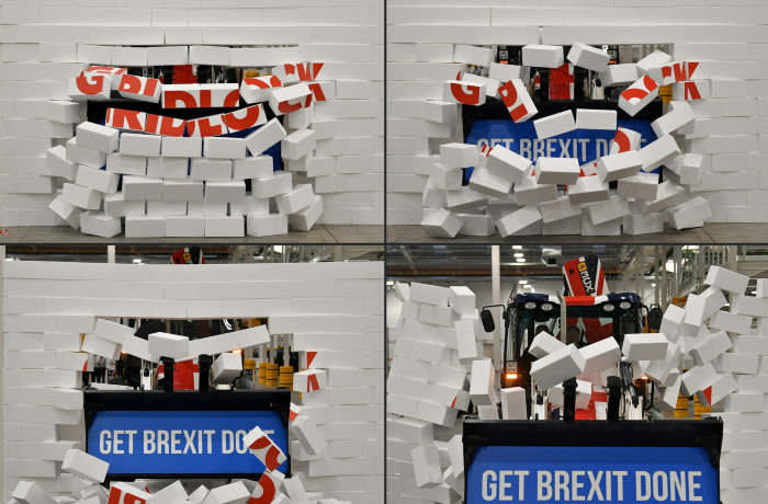 """(COMBO) This combination of pictures created and taken on December 10, 2019 shows Britain's Prime Minister and Conservative party leader Boris Johnson as he drives a Union flag-themed JCB, with the words """"Get Brexit Done"""" inside the digger bucket, through a fake wall emblazoned with the word """"GRIDLOCK"""", during a general election campaign event at JCB construction company in Uttoxeter, Staffordshire. Britain's Prime Minister and Conservative party leader Boris Johnson drives a Union flag-themed JCB, with the words """"Get Brexit Done"""" inside the digger bucket, through a fake wall emblazoned with the word """"GRIDLOCK"""", during a general election campaign event at JCB construction company in Uttoxeter, Staffordshire, on December 10, 2019. Britain's Prime Minister and Conservative party leader Boris Johnson drives a Union flag-themed JCB, with the words """"Get Brexit Done"""" inside the digger bucket, through a fake wall emblazoned with the word """"GRIDLOCK"""", during a general election campaign event at JCB construction company in Uttoxeter, Staffordshire, on December 10, 2019. Britain's Prime Minister and Conservative party leader Boris Johnson drives a Union flag-themed JCB, with the words """"Get Brexit Done"""" inside the digger bucket, through a fake wall emblazoned with the word """"GRIDLOCK"""", during a general election campaign event at JCB construction company in Uttoxeter, Staffordshire, on December 10, 2019. - Britain will go to the polls on December 12, 2019 to vote in a pre-Christmas general election. (Photos by Ben STANSALL / POOL / AFP) (Photo by BEN STANSALL/POOL/AFP via Getty Images)"""
