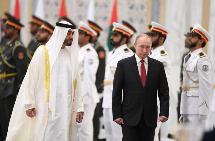 Russian President Vladimir Putin (R) reviews an honour guard with Sheikh Mohamed bin Zayed al-Nahyan, Crown Prince of Abu Dhabi, during an official welcoming in the Emirati capital's Al-Watan presidential palace on October 15, 2019. (Photo by KARIM SAHIB / AFP) (Photo by KARIM SAHIB/AFP via Getty Images)