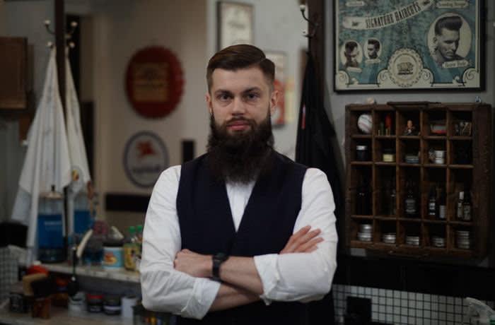 Mateusz Grodzicki, the barber in the Poles get richer piece. James Shotter