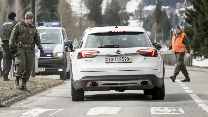LANDECK, AUSTRIA - MARCH 14: Police at a roadblock stop cars from driving into and out of Sankt Anton following the imposition of a quarantine due to the coronavirus on March 14, 2020 near Landeck, Austria. The ski resort towns of Sankt Anton and Ischgl are both under quarantine and many ski resorts in the region have been closed. The Austrian government is pursuing aggressive measures, including closing schools, cancelling events and shuttering shops except for grocery stores and pharmacies in an effort to slow the ongoing spread of the coronavirus. (Photo by Jan Hetfleisch/Getty Images)
