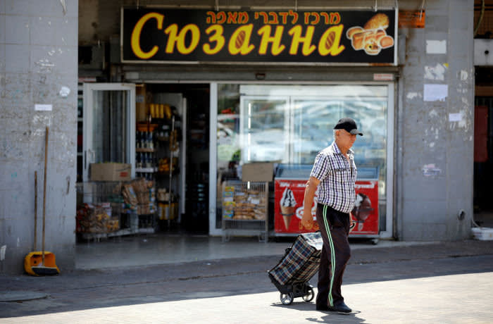 A Russian-speaking immigrant from the former Soviet Union walks near a Russian bakery in Ashdod, Israel September 9, 2019. Picture taken on September 9, 2019 REUTERS/Amir Cohen