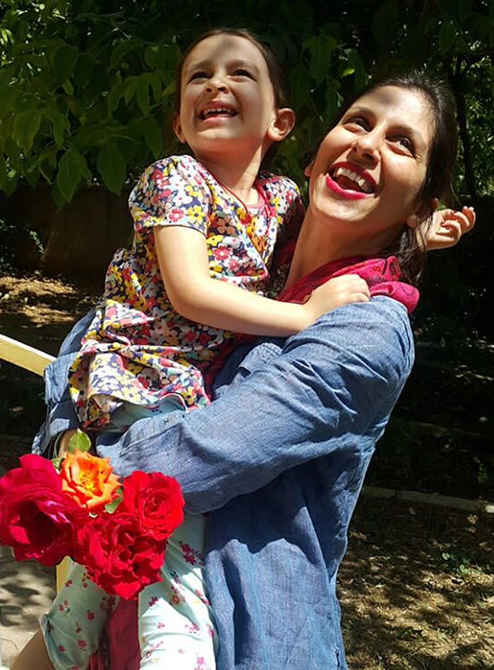 In this undated photo provided by the Free Nazanin Campaign, Nazanin Zaghari-Ratcliffe hugs her daughter Gabriella, in Iran. Zaghari-Ratcliffe has been allowed to leave an Iranian prison for three days, her husband said Thursday, Aug. 23, 2018. Zaghari-Ratcliffe was arrested during a holiday with her toddler daughter in April 2016. Iranian authorities accuse her of plotting against the government. Her family denies this, saying says she was in Iran to visit family. (Free Nazanin Campaign/via AP)