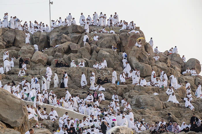Muslim pilgrims gather at the Jabal Al Rahma holy mountain, or the mountain of forgiveness, at Arafat for the annual hajj pilgrimage outside the holy city of Mecca, Saudi Arabia, Monday, Aug. 20, 2018. More than 2 million Muslims have begun the annual hajj pilgrimage. The five-day pilgrimage represents one of the five pillars of Islam and is required of all able-bodied Muslims once in their life. (AP Photo/Dar Yasin)