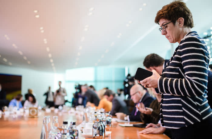epa07850002 German Defense Minister Annegret Kramp-Karrenbauer looks on her phone during the beginning of a cabinet meeting at the Chancellery in Berlin, Germany, 18 September 2019. The cabinet of the German government meets on a regular basis. EPA-EFE/CLEMENS BILAN
