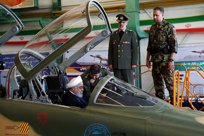 """A handout picture released by the Iranian Presidency on August 21, 2018, shows President Hassan Rouhani sitting in the cockpit of the """"Kowsar"""" domestic fighter jet, a fourth-generation fighter, with """"advanced avionics"""" and multi-purpose radar, which the local Tasnim news agency said was """"100-percent indigenously made"""". - Iran unveiled its first domestic fighter jet at a defence show in the capital Tehran today. (Photo by HO / Iranian Presidency / AFP)HO/AFP/Getty Images"""