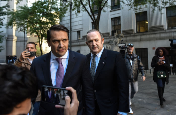 NEW YORK, NY - OCTOBER 23: Igor Fruman (C) exits federal court for an arraignment hearing on October 23, 2019 in New York City. Lev Parnas and Igor Fruman, along with Andrey Kukushkin and David Correia, are associates of Rudy Giuliani who have been arrested for allegedly conspiring to circumvent federal campaign finance laws in schemes to funnel foreign money to U.S. candidates running for office at the federal and state levels.(Photo by Stephanie Keith/Getty Images)