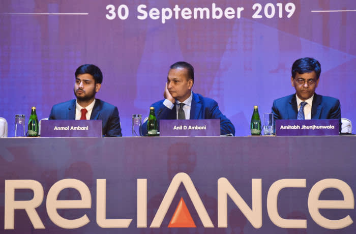 MUMBAI, INDIA - SEPTEMBER 30: Reliance Group Chairman Anil Ambani with his son Jai Anmol Ambani and Reliance Capital's Vice Chairman Amitabh Jhunjhunwala, during the Reliance Annual General Meetings at KC College, on September 30, 2019, in Mumbai, India. (Photo by Anshuman Poyrekar/Hindustan Times via Getty Images)