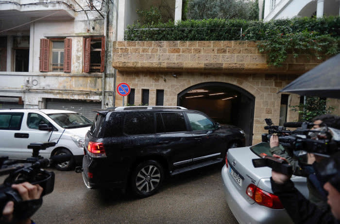 Journalists film a vehicle entering the underground parking of a house identified by court documents as belonging to former Nissan chief Carlos Ghosn in a wealthy neighbourhood of the Lebanese capital Beirut on January 3, 2020. - Former Renault-Nissan boss Carlos Ghosn, who skipped bail in Japan and fled to Beirut, is due to be summoned by Lebanon's public prosecutor next week, an official said. Ghosn, once Japan's best paid corporate executive, was arrested in November 2018 and has been under house arrest since April, facing multiple charges of financial misconduct. (Photo by JOSEPH EID / AFP) (Photo by JOSEPH EID/AFP via Getty Images)