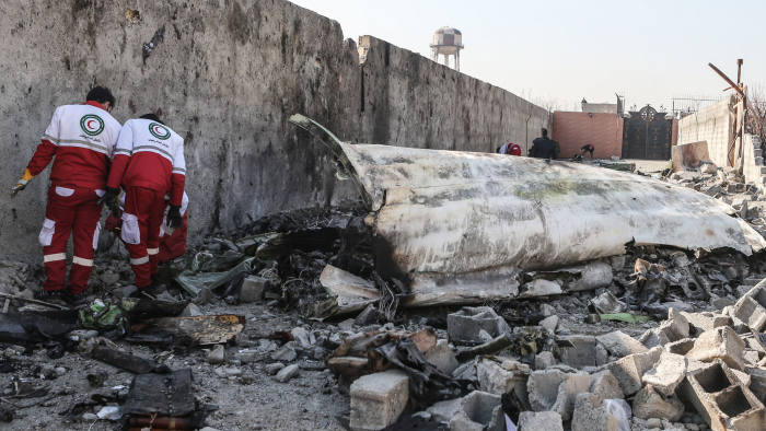 08 January 2020, Iran, Shahedshahr: Rescue workers search the scene, where the Ukrainian plane crashed. A Ukrainian airplane carrying 176 people crashed on Wednesday shortly after takeoff from Tehran airport, killing all onboard. Photo: Mahmoud Hosseini/dpa