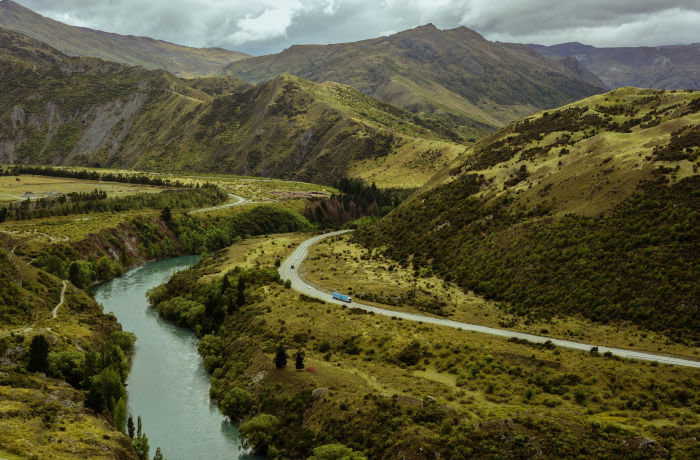 New Zealand mountains and glacial river.
