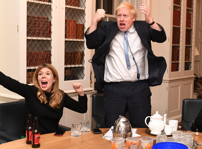 Image ©Licensed to i-Images Picture Agency. 13/12/2019. London, United Kingdom. Boris Johnson Election Night. Britain's Prime Minister Boris Johnson and his partner Carrie Symonds watch the 2019 Election results on the TV in his study in No10 Downing Street. Picture by Andrew Parsons / i-Images