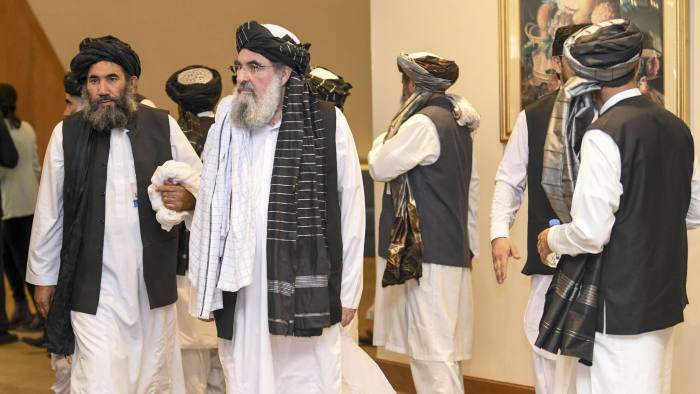 Mandatory Credit: Photo by STRINGER/EPA-EFE/Shutterstock (10570926v) Mullah Abdul Salam Zaeef (L), senior official of the Afghan Taliban, arrives to the signing of a US-Taliban agreement in Doha, Qatar, 29 February 2020. The United States and the Taliban on 29 February penned a agreement to bring peace to Afghanistan which paves the way for the withdrawal of US troops and intra-Afghan negotiations. US and Taliban sign peace deal in Qatar, Doha - 29 Feb 2020