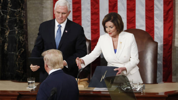 Mandatory Credit: Photo by SHAWN THEW/EPA-EFE/Shutterstock (10548310y) Speaker of the House Nancy Pelosi (R) reaches out towards US President Donald J. Trump (C) as Vice President Mike Pence (L) watches as Trump arrives to deliver his State of the Union address during a joint session of congress in the House chamber of the US Capitol in Washington, DC, USA 04 February 2020. President Trump delivers his address as his impeachment trial is coming to an end with a final vote on the 2 articles of impeachment scheduled for 05 February. US President Donald J. Trump delivers his State of the Union address, Washington, USA - 04 Feb 2020