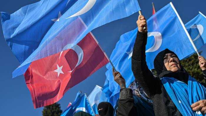TOPSHOT - Supporters of China's Muslim Uighur minority wave flags of East Turkestan and Turkey during a demonstration at Beyazid square in Istanbul on December 14, 2019. - Arsenal's Mesut Ozil, a German footballer of Turkish origin, expressed on December 14, 2019 support for Uighurs in Xinjiang and criticised Muslim countries for their failure to speak up for them. (Photo by Ozan KOSE / AFP) (Photo by OZAN KOSE/AFP via Getty Images)