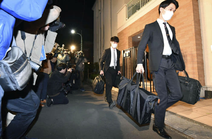 Officials from the Tokyo District Public Prosecutors Office carry bags after raiding the Tokyo residence of former Nissan chairman Carlos Ghosn in Tokyo, Japan in this photo taken by Kyodo January 2, 2020. Mandatory credit Kyodo/via REUTERS ATTENTION EDITORS - THIS IMAGE WAS PROVIDED BY A THIRD PARTY. MANDATORY CREDIT. JAPAN OUT.