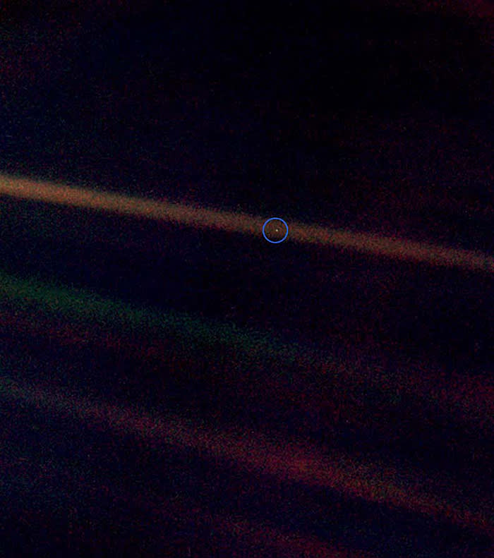 Earth, described by astronomer Carl Sagan as a 'mote of dust suspended in a sunbeam', photographed by the Voyager 1 space probe at a distance of more than four billion miles in February 1990