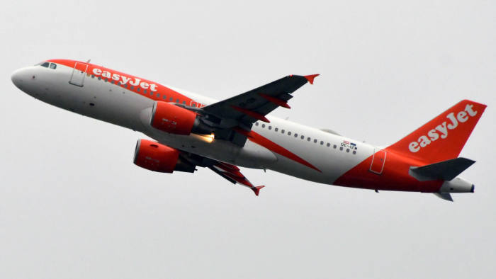 (FILES) In this file photo taken on November 15, 2019 an Airbus A320-214 of British airline Easyjet (OE-IZW) is pictured after taking off from the Airbus delivery center, in Colomiers, near Toulouse, southwestern France. - The British airline EasyJet announced on December 4, 2019 that 233 domestic and medium-haul flights will be cancelled on December 5, 2019 due to the national strike against the pension reform planned in France. (Photo by PASCAL PAVANI / AFP) (Photo by PASCAL PAVANI/AFP via Getty Images)