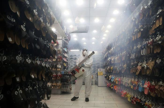 Fire fighter teams disinfect Tehran's Tajrish Bazaar as a precaution against coronavirus