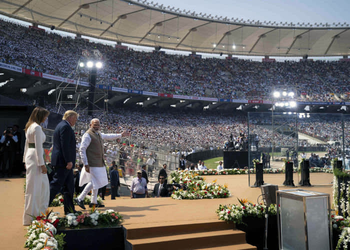 Narendra Modi with the US president and his wife Melania at a packed rally in Ahmedabad on February24—part of a lavish official visit