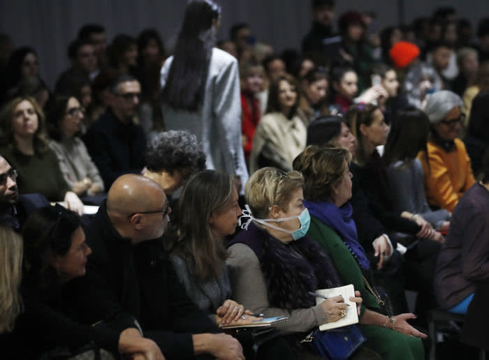 Spectators and journalists at a fashion show in Milan