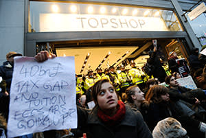 Protesters against tax avoidance by big business outside the Topshop flagship store in December 2010