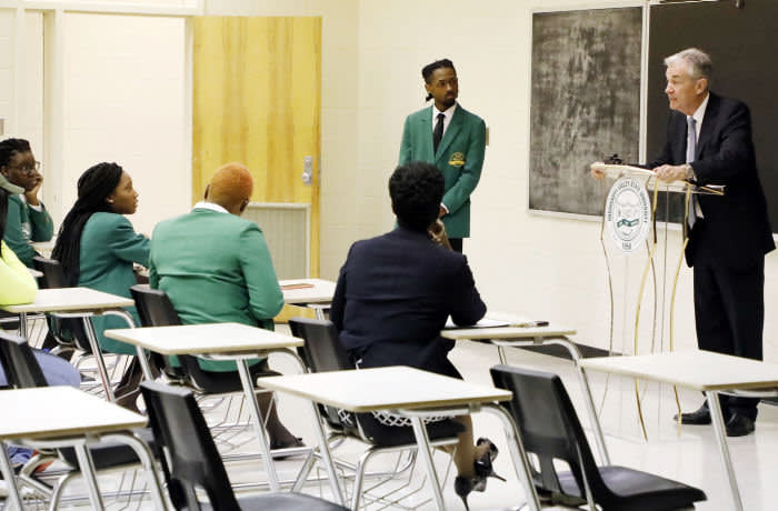 Federal Reserve Chairman Jerome Powell, right, says he doesn't see elevated recession risks, during a visit to a class of students and faculty, at historically black Mississippi Valley State University in Itta Bena, Miss., Tuesday, Feb. 12, 2019. Powell says that many rural areas have not benefited from the national prosperity and those areas need special support. Powell visited the school as part of his speaking before a rural policy forum at the school. (AP Photo/Rogelio V. Solis)
