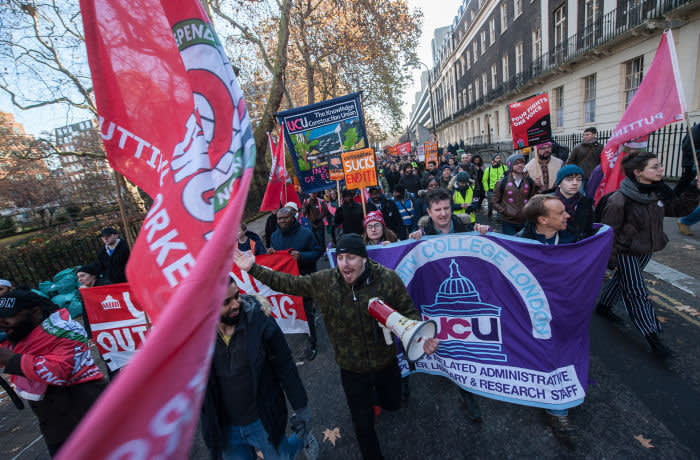 LONDON, ENGLAND - DECEMBER 04: Striking members of the UCU and IWGB at UCL march together towards the headquarters of UUK. on December 4, 2019 in London, England. Striking members of the UCU (lecturers) trade union at University College London (UCL) are joined by security guards and cleaners whom are members of the IWGB trade union and also on strike against outsourcing at UCL. Both unions had a joint march to the headquarters of UUK and UCL. (Photo by Guy Smallman/Getty Images)