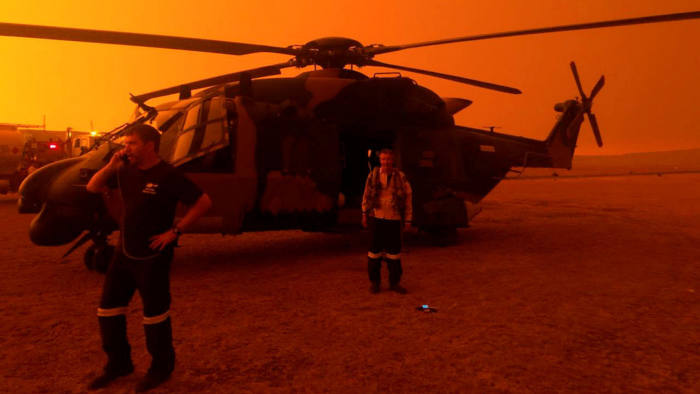 Australian 6 Aviation Regiment MRH90 helicopter providing support to RFS at Polo Flat, Cooma January 4, 2020. Australia 6 Aviation Regiment/Australian Army/Department of Defence/Handout via REUTERS THIS IMAGE HAS BEEN SUPPLIED BY A THIRD PARTY. NO RESALES. NO ARCHIVES